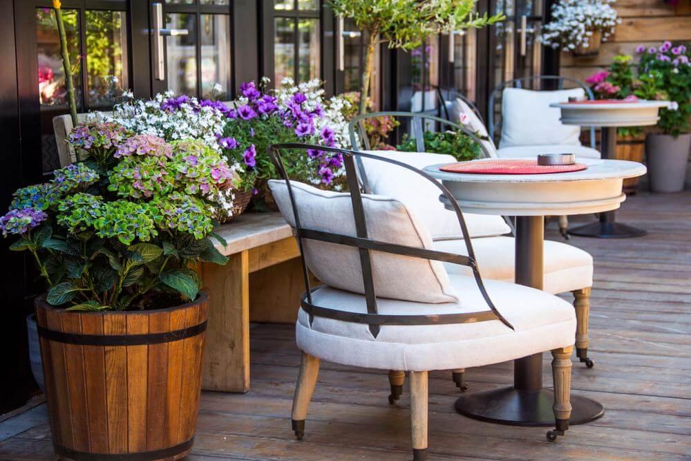 Barrel flower pot on a patio.