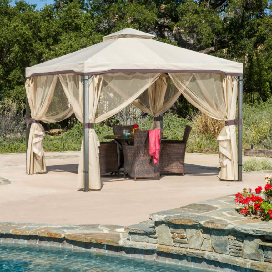 These breezy curtains give an Arabian feel with their light colors. The screens can be draped out to prevent bugs, but when tied back they give a nice elegant look.