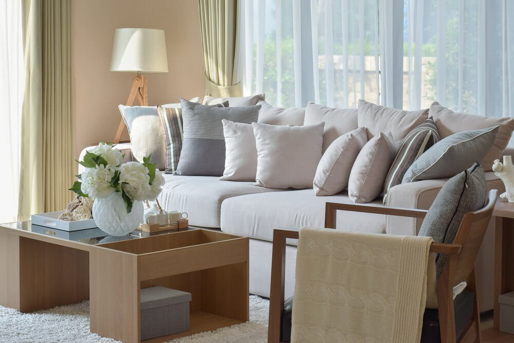 Example of solid throw pillows matching the couch fabric.