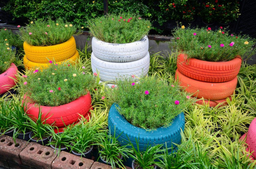 A series of painted tire planters stacked 2 and 3 high creating a lovely colorful garden.
