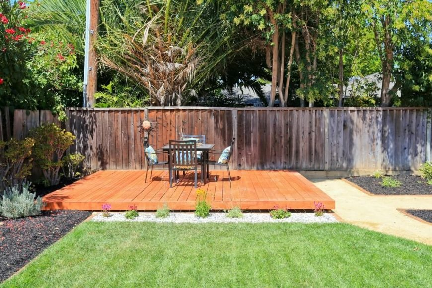 Here's another simple, minimalist floating deck design. The bright wood stain helps it stand out in the midst of a carefully designed landscape.