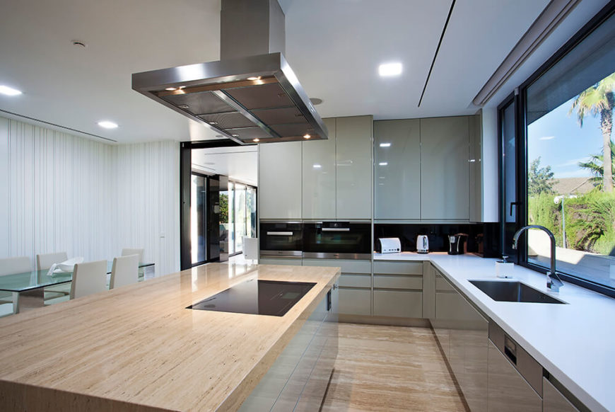 This minimalist kitchen is clean and uncluttered. There are lots of clean and straight lines and stainless steel features. The modern and functional appeal is strong and unfussy.