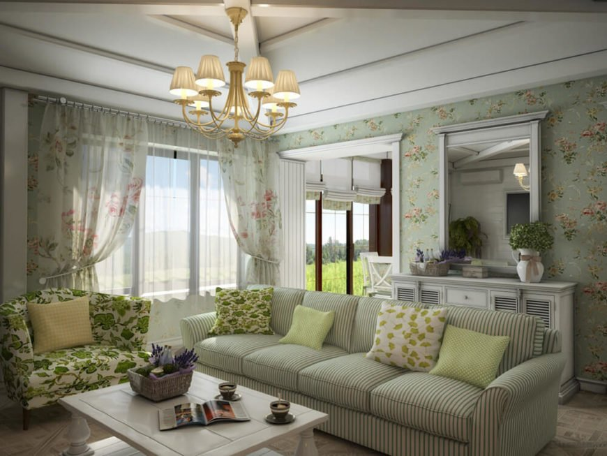 Large windows cast an abundance of natural light across this lightly colored space. The extra large sofa and floral print armchair anchor the contemporary room in a more traditional style.