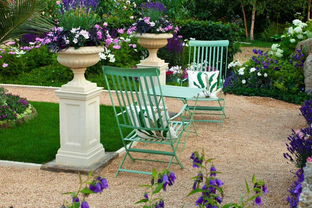 Patio columns with ornate flower pots.