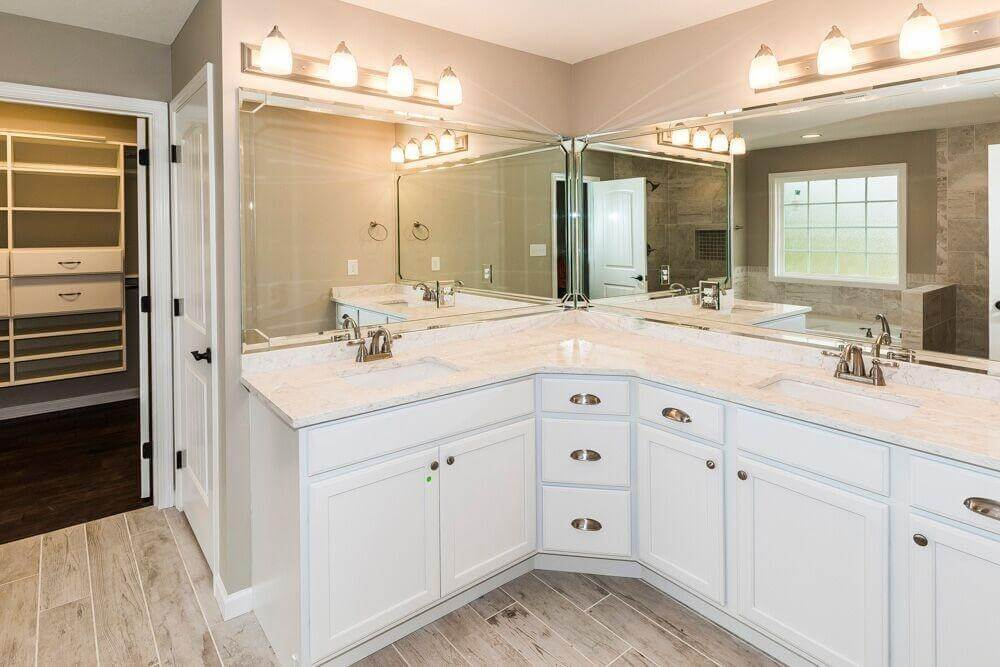 White and Cream Bathroom with Attached Closet
