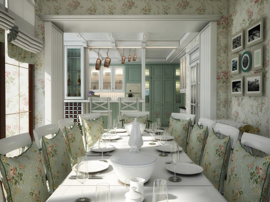 The dining room is an eruption of fine detail, with floral elements wrapping the walls and appearing on the seat cushions. This acts as a nice contrast to the bold white surroundings and furniture.