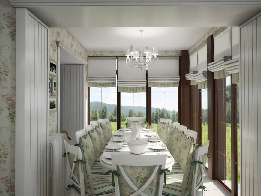 The dining room is completely wrapped in tall windows for a greenhouse-like effect.