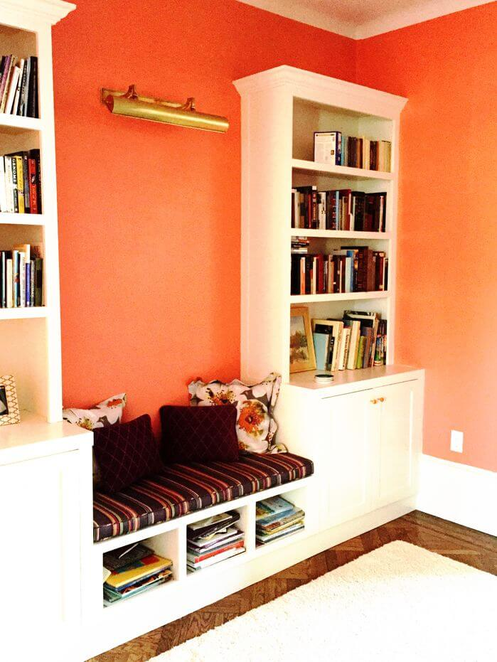 This cozy nook is tucked away between two well-stocked bookshelves. This makes a fun spot to escape to get lost in a book with many more on deck for when you don't want the stories to end.