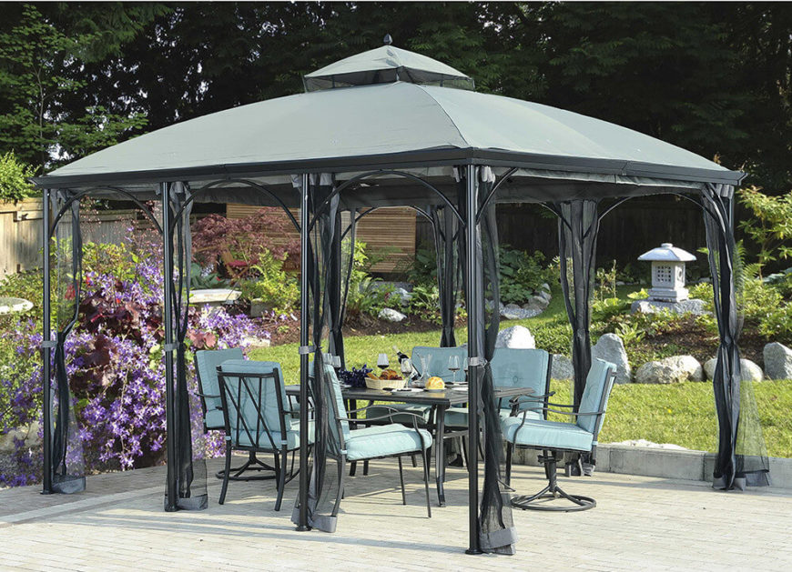This gazebo has sheer net curtains that can be drawn to keep bugs out, then tucked away when you no longer need them.