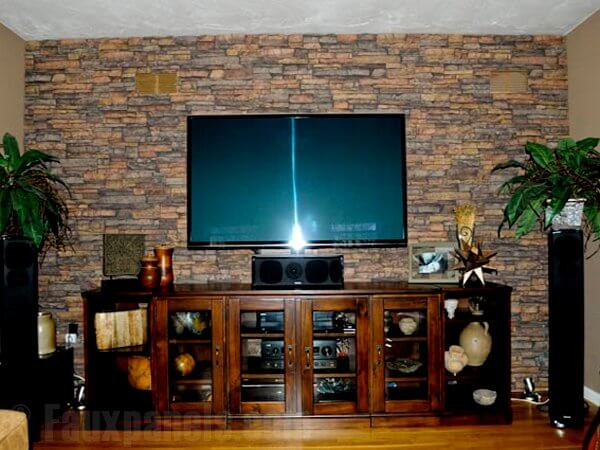 """The color contrast between each """"stone"""" has been upped for this accent wall, which sits behind a large entertainment center and television."""