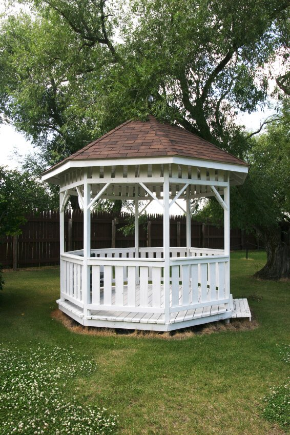 Here is a classic example of a simple white gazebo that adds a nice design element to a yard. Even in a simple yard the gazebo can give a central focus. This emphasis stages the entire yard for great design.