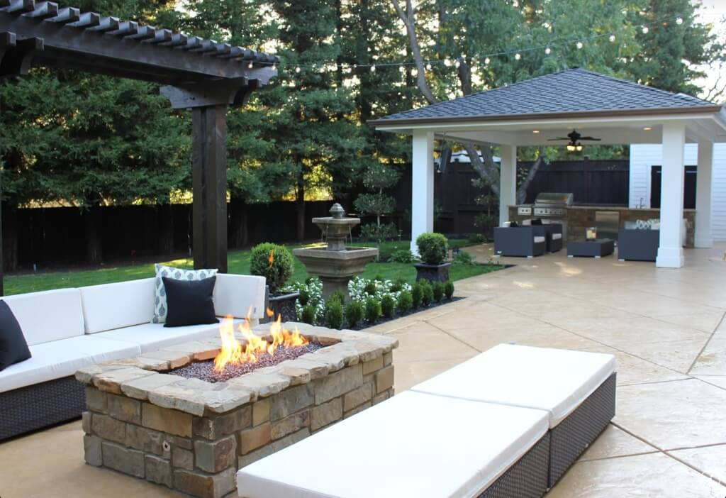 This gazebo has multiple lighting features and houses some relaxing and inviting patio furniture as well as a bar. This gazebo is the best spot to spend a lazy afternoon outside.