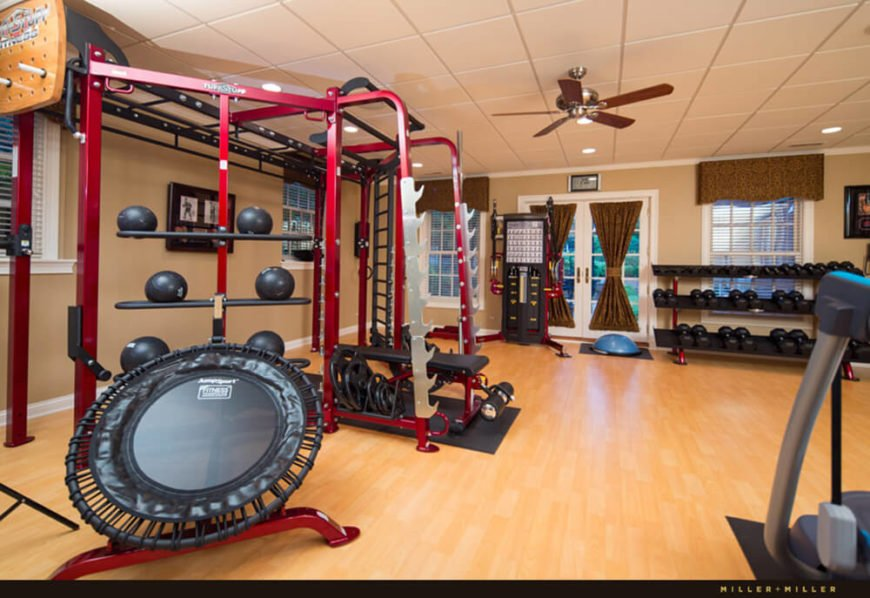 The home gym is one of the most well-equipped we've ever seen, outfitted like a professional gym. With direct patio access and a vast open floor plan, it's a welcoming space within the home.