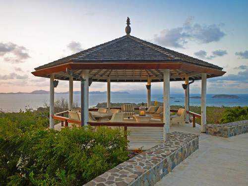This gazebo set off the side of this patio is large enough for a variety of furniture. It has a relaxing lounge area as well as a dining area to have peaceful meals while taking in the scenery.
