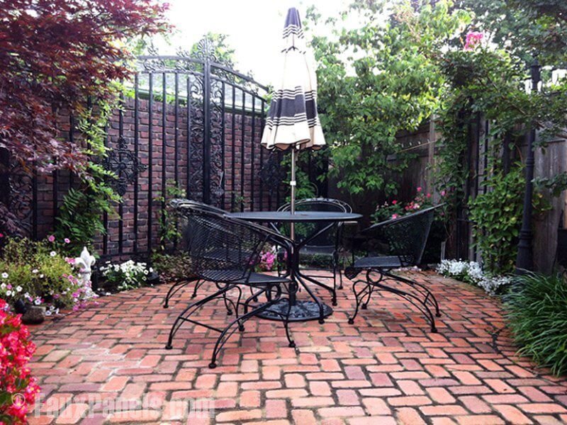 This is an interesting example of faux brick being using in a garden setting. In areas where the fence is wrought iron and open to prying eyes, the privacy fence beyond is paneled in faux brick.