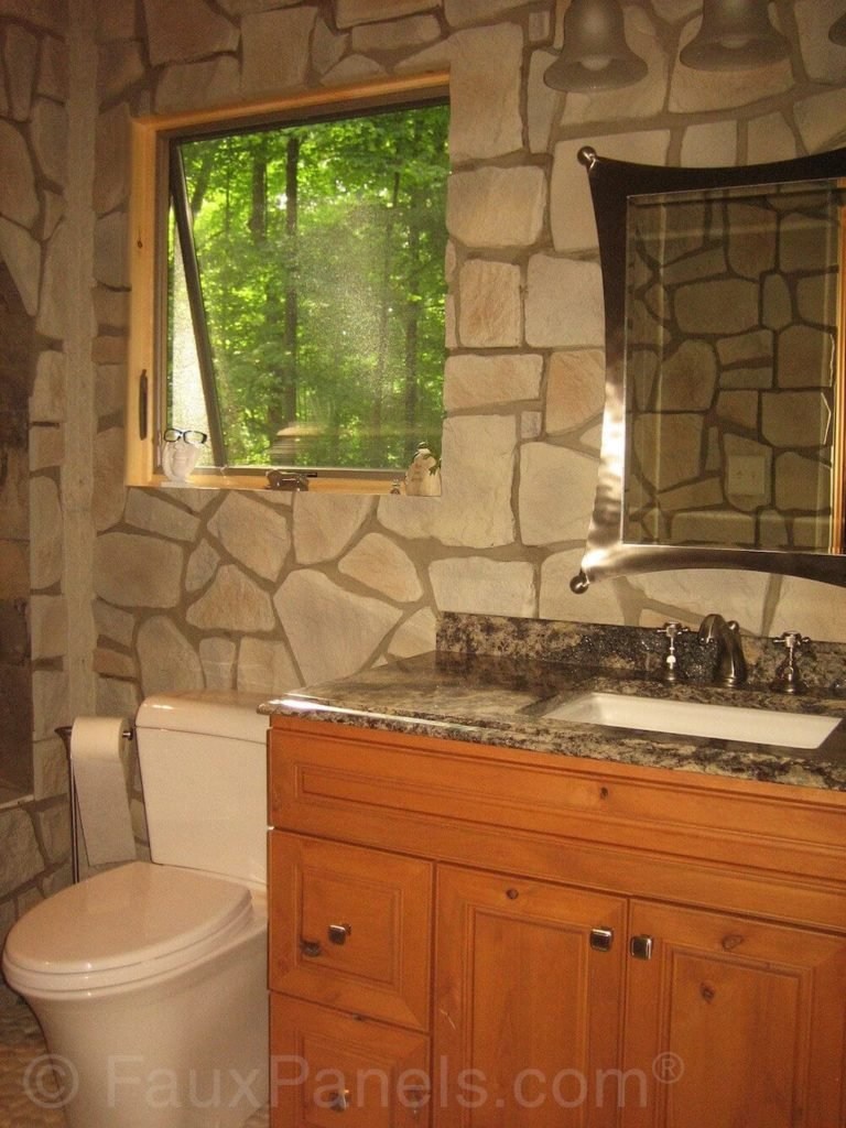 The thick grout lines and stones in different shapes and sizes make the faux stone look as real as can be. The stone gives this bathroom a decidedly castle-like atmosphere.