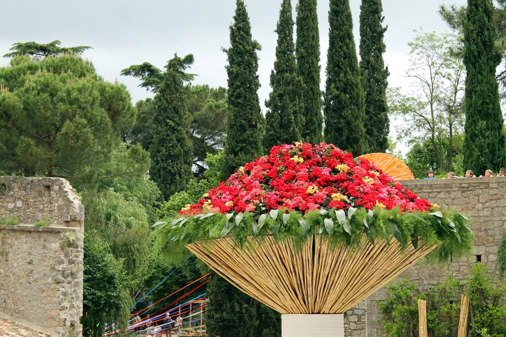 Wild flower pot made form bamboo sticks elevated to look like a large torch.
