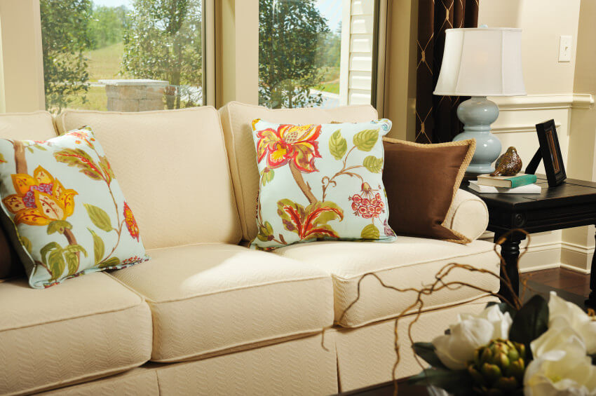 Example of floral pillows on traditional sofa.