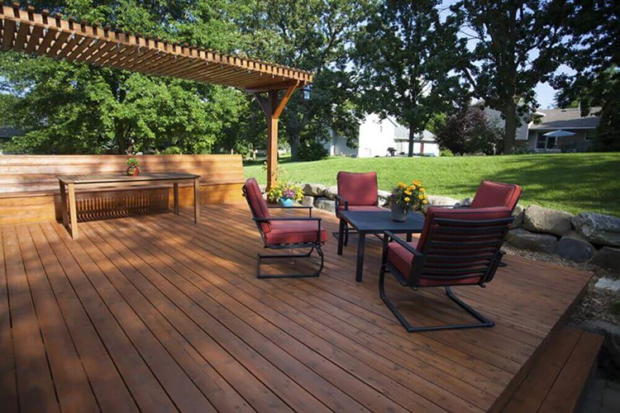 This beautiful deck was our featured image at the top because it is not only expansive and well-made, but stylish as well. The deck features a built-in bench running the full length, with matching table and pergola.