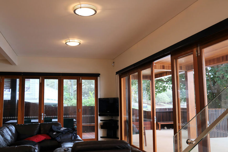 Back down on the first floor, we see the expansive views found in the living room, through the folding glass panel doors. These can be fully retracted to combine the living room and deck spaces.