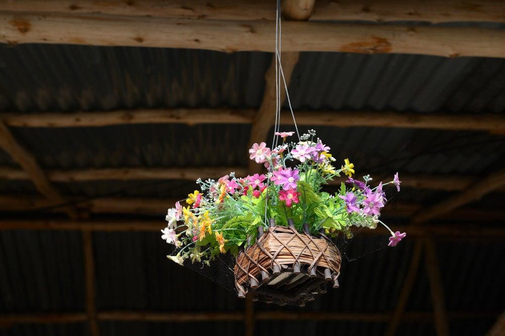 Small colourful flower bouquet in a custom wicker style basket.