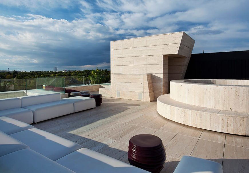 Here is a rooftop area designed for hanging out and enjoying the view over the landscape. The minimalistic furniture offer a great deal of seating;from any seat you have a perfect view over the countryside.