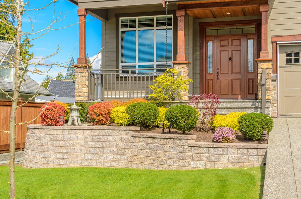 The green, purple, orange and yellow non-flowering shrubs can be as decorative as flowering plants.