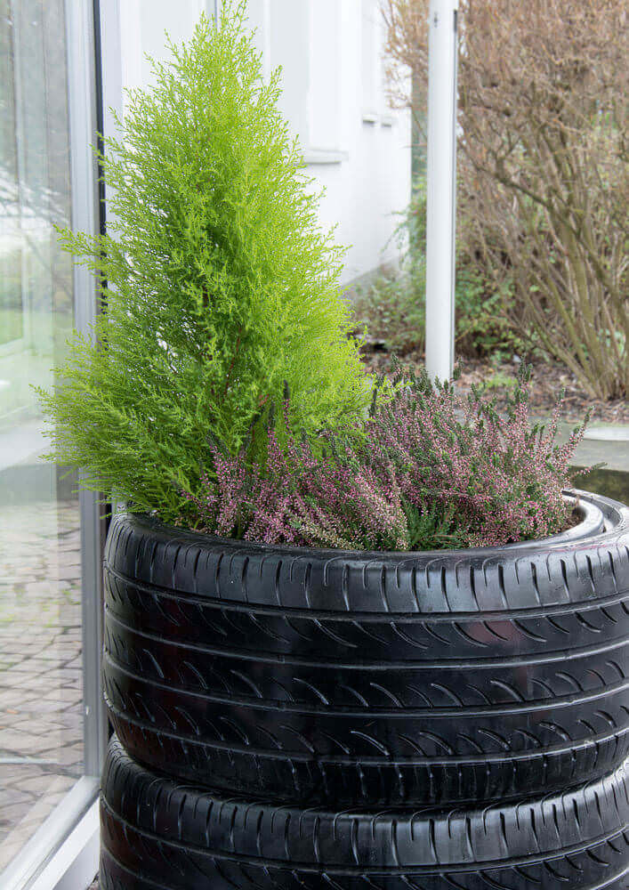 2 stacked tires serving as patio flower pot.