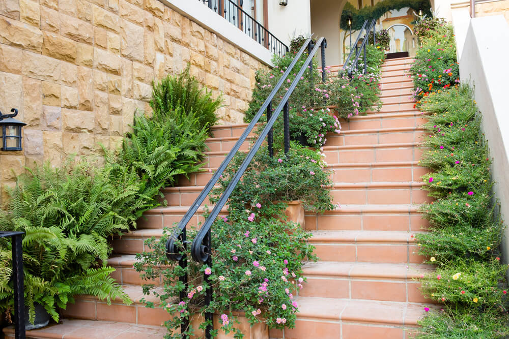 This is quite hard to maintain yet the result is so beautiful. The green bushes in each corner sitting on every step are so calming to the eyes.