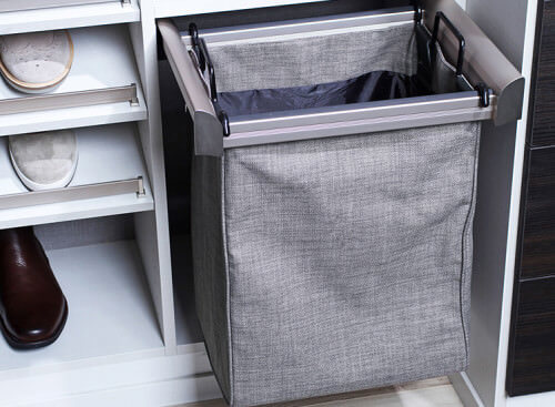 Organize and hide your laundry in this pull-out hamper that comes in a cool slate grey color.