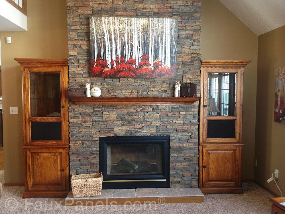 The faux stone paneling on this fireplace surround transforms an otherwise plain drywall surround for a gas fireplace into something much more impressive and costly looking.
