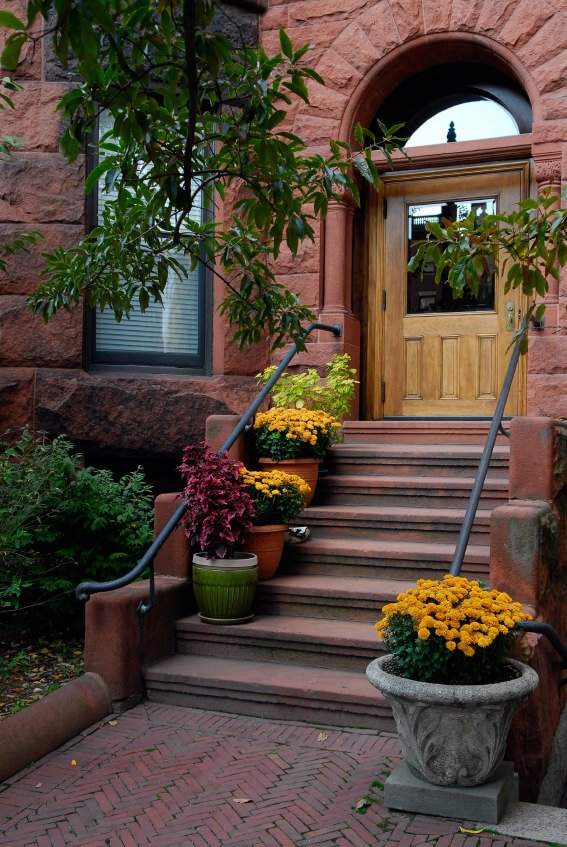Old and dusty steps are decorated with huge pots of different styles and colors. Add up the thick and bright yellow blossoms of chrysanthemum that give a lifeless staircase another hope to be appreciated.