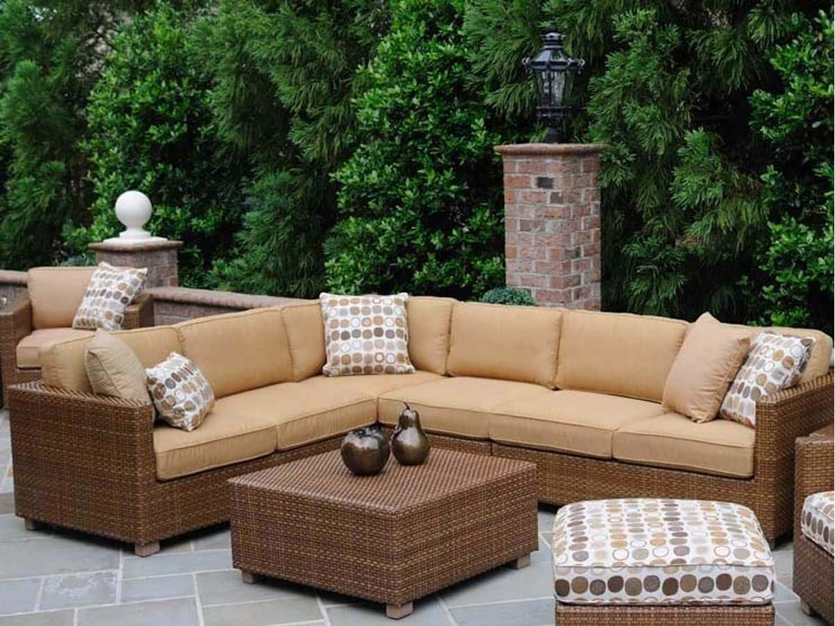 Large patio brown sectional sofa with ottoman style coffee table