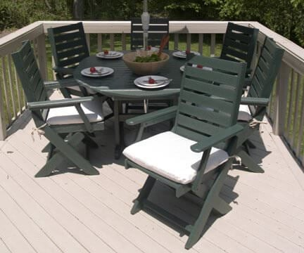 Dark green patio dining set with folding wood chairs
