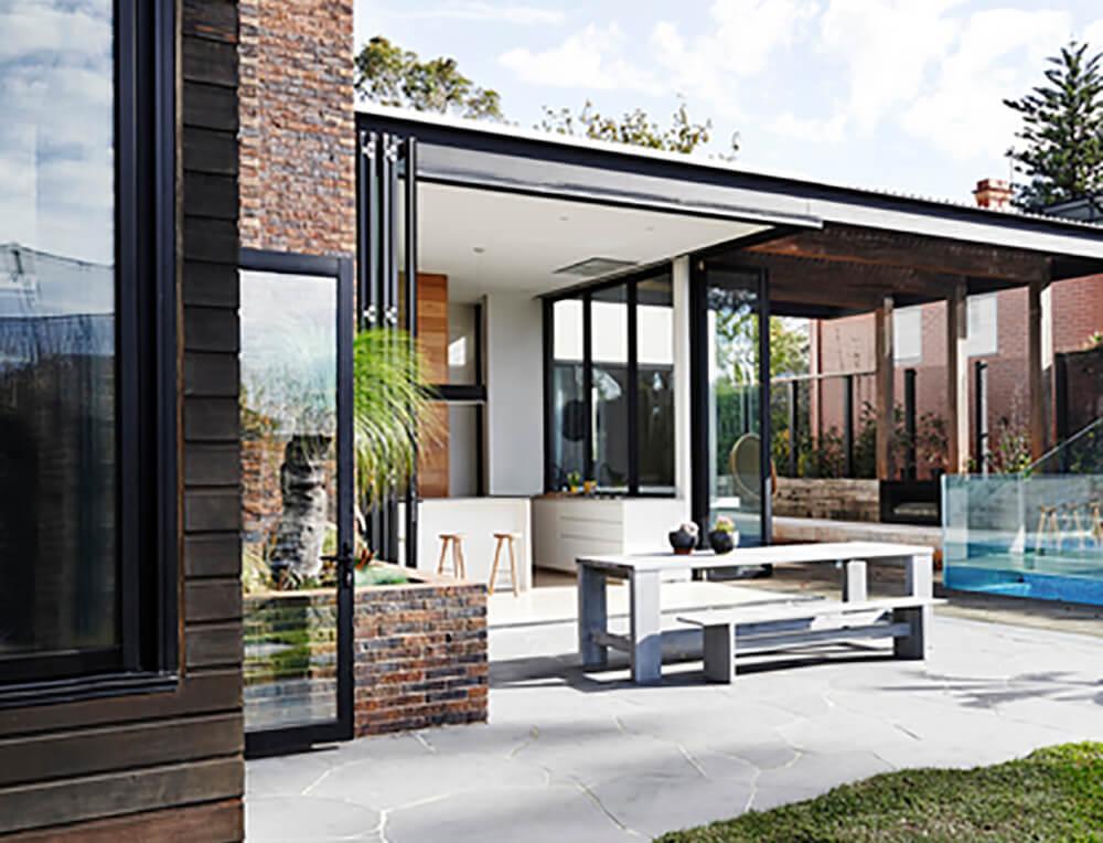 Wood and Brick Walls Bring This Modern Interior To Life