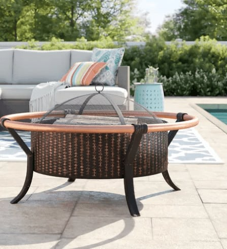 Screen covered round patio fire pit.