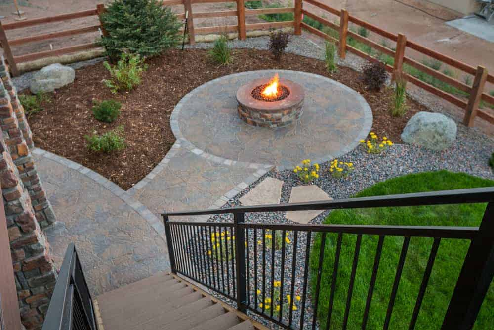 Aerial view of large round propane fire pit on matching round patio.