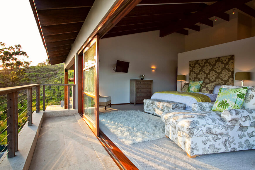 Seen from outside, the bedroom stands distinct with a shorter dividing wall beneath the soaring vaulted ceiling. This helps further enhance the open feel of the home design.