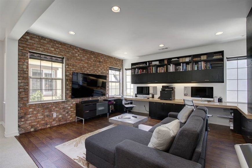 A brick wall is an industrial feature that looks great in family rooms, regardless of if you have young children or older children.