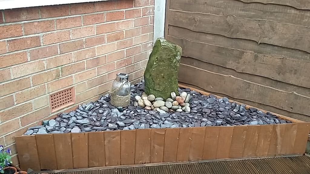 """Raised beds can go anywhere and be home to anything! They don't even have to be used for gardens. This particular """"garden"""" is a beautiful water feature and it uses the same principles of a raised bed."""