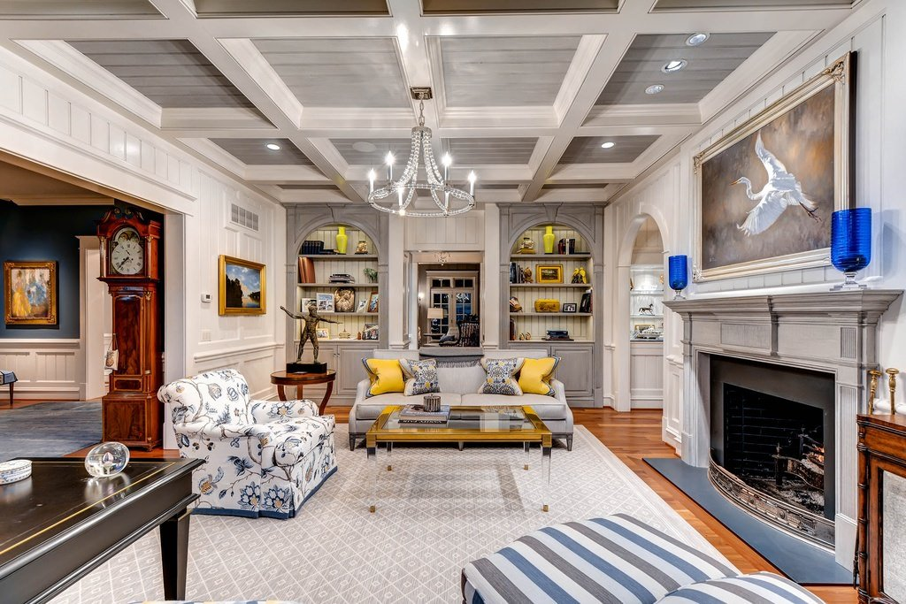 Lively accents of bright yellow and blue awaken the spirit of this area. A few figures and frames are on the shelves while the handmade seat and pillow cover unravel past.