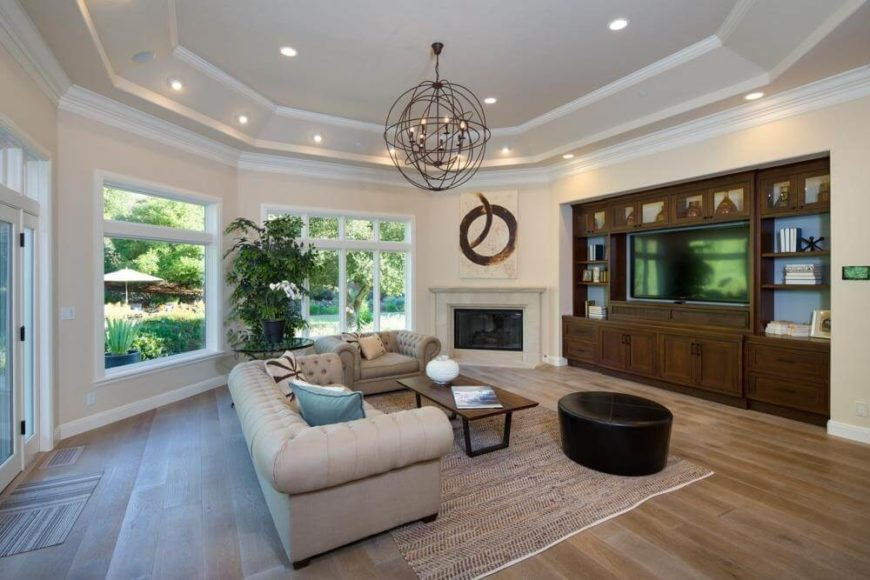 A two-tier tray ceiling gives this spacious family room a bit more height, and serves as a convenient place to create more lighting.
