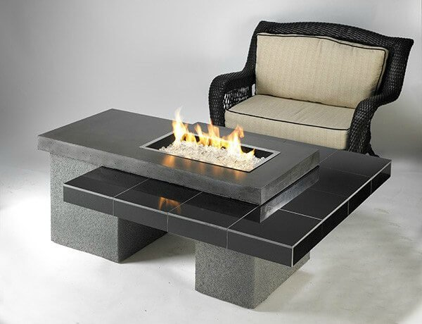 Want your own personal fire pit table that looks good in black? Try out this ultra modern propane patio fire pit. This fire pit table is made with a black granite tile and gray supercast top, which you can use when the fire pit is not in use. It is very easy to use and you can easily hide your propane tank in its base.