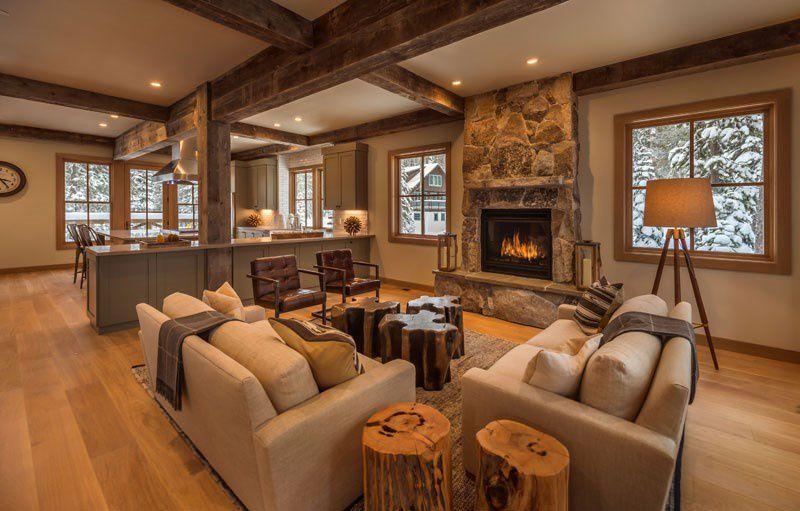 A searing hot fireplace gives warmth to the area while wooden furniture is attractive in its unique look.