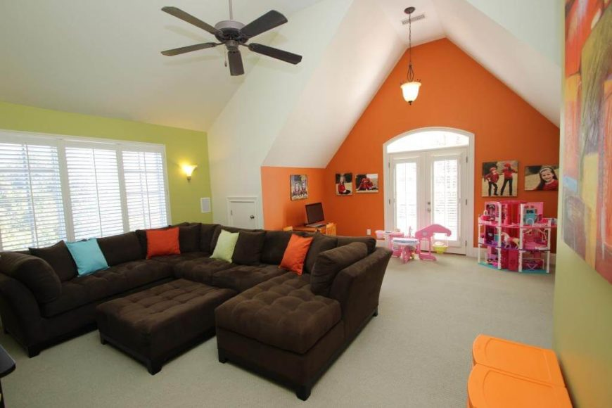 Tall ceilings give this family room a sense of space that's perfect in an attic family room and playroom.
