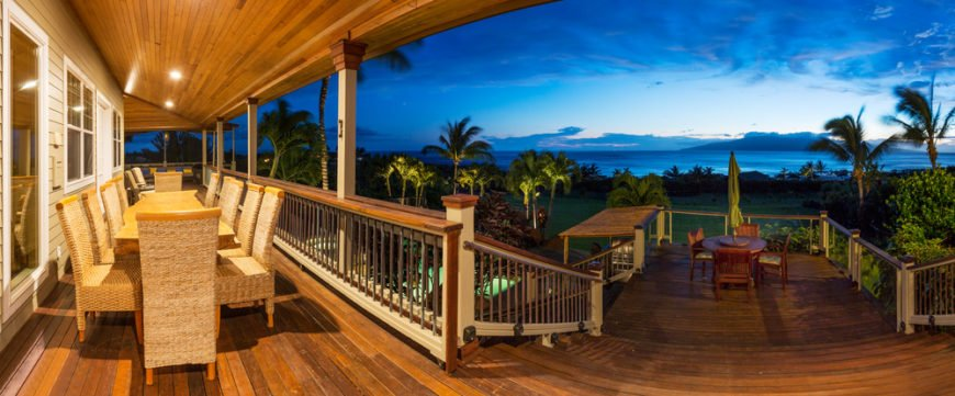 Close to the home is a wicker dining set. A wide set of stairs leads down to a more intimate dining set, and various other levels lead down to the patio below, where the pool is located.