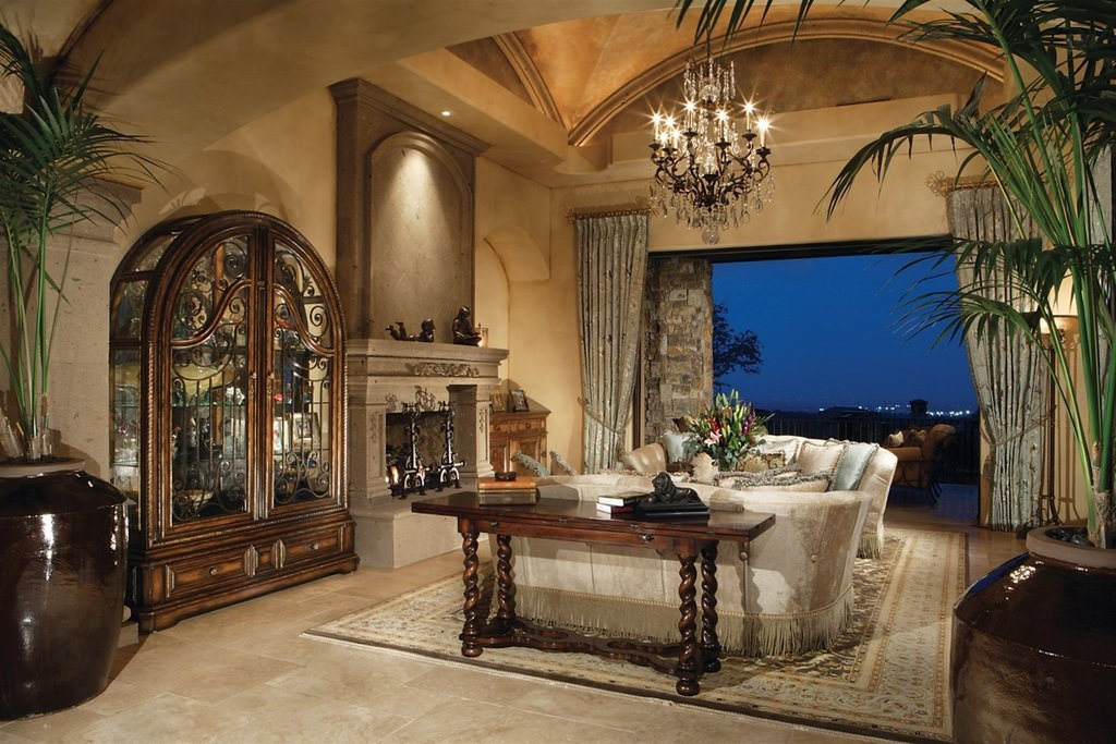 This design is quite stunning with its very elegant traditional set up. Elaborately designed furniture carving and molding, a few decorative accents like candle holders and over-sized pots and high curtains are flaunting an old fashioned yet very classy touch.