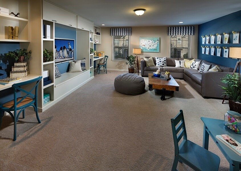 Using brighter colors, like blue, as accent colors is a great way to add a bit of fun to a family room