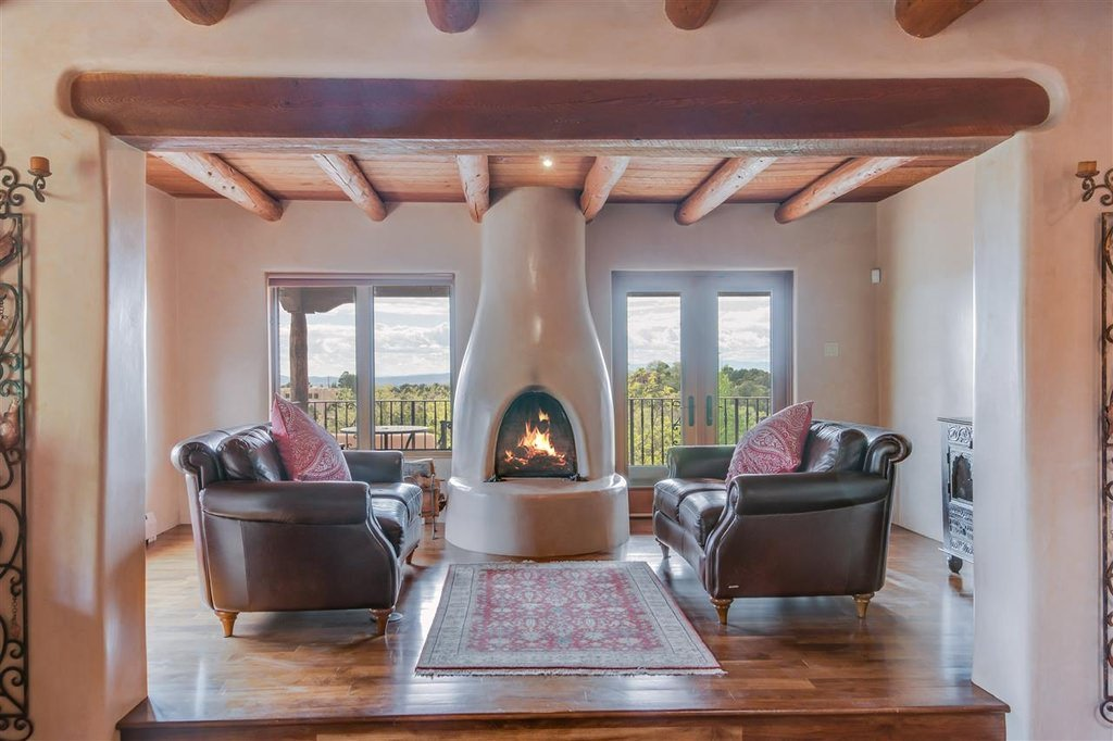 A specially made fireplace centers the living area with no other added furniture like center table, only a pair of sofas and throw pillows.