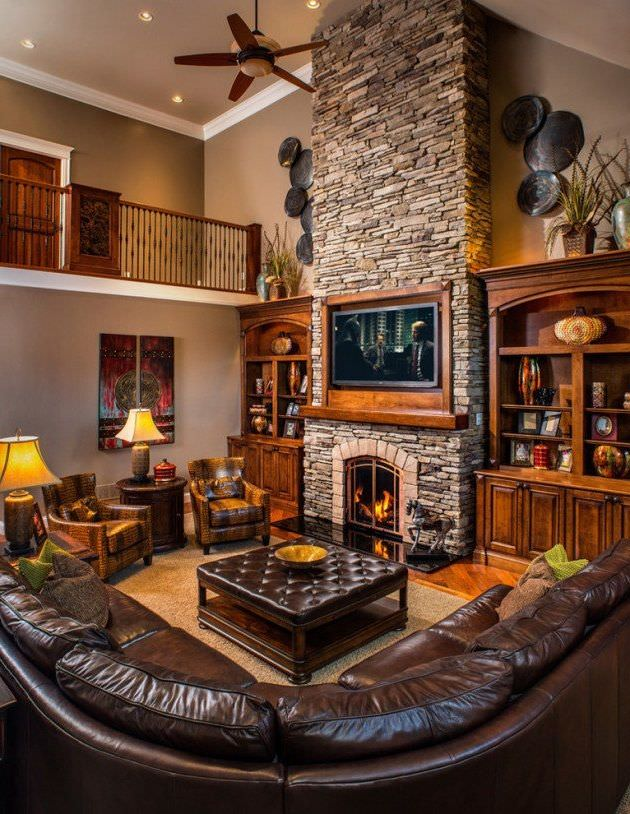 Quite an overwhelming design of a rustic living room with mahogany colored sofa and ottoman in the center. Rustic hanging wall decor and potted plants show the nature and earthy side of the design.